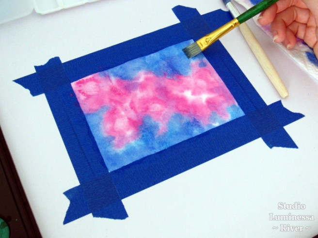 Wetting a watercolor painting for adding color using wet-on-wet technique.