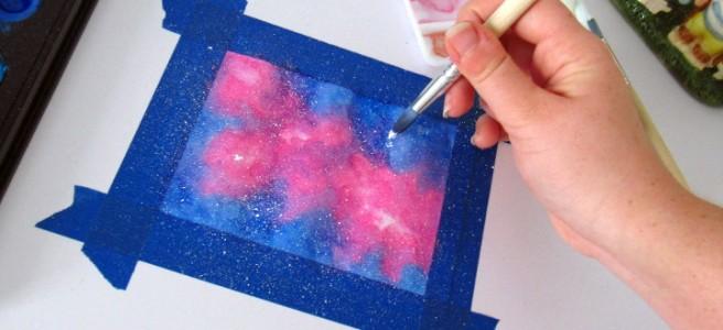 Adding bigger stars with white paint and the round brush.